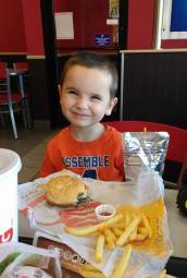 This little boy right here, he's my hero. You see, this picture was taken at an everyday fast food restaurant where I'm sure hundreds if not thousands of other parents have taken similar photos of their children. Amongst the scrunched-nosed smile and the half-eaten cheeseburger it's hard to see the magic in this moment. This is one of the first times we've been able to eat at a restaurant like this. I know that probably sounds strange to most of you, but for me and my son this was truly a special occurrence because up until a year ago he couldn't chew most table foods. My sweet, first-born son has autism and along with that diagnosis he's suffered from severe food aversions and was extremely sensory defensive. It was something we noticed very early on when he wouldn't even eat Gerber puffs at around 6 months, and table foods made him gag. He even started to choke one time on a piece of ravioli that we had cut up into the size of a dime. My husband had to throw his highchair tray across the room to pull him out of it to prep to administer the Heimlich, but thankfully he coughed it up on his own. To say were shaken by that would be an understatement! Most parents won't understand this struggle. They won't understand the many play dates we went on, and while all of the other kids were eating goldfish crackers and cookies, my son was still eating baby food at two years old. They won't understand the countless times I had to explain the situation, only to get looked upon with blank faces and drawn in eyebrows from other moms who just didn't understand. We couldn't go out to eat for the first four years of his life without bringing his own special pureed food from home. You probably don't think about how much it'd break your heart not to be able to give your toddler a bite of your pizza because he'd either choke on it or just not eat it at all? But, after years of intense occupational and speech therapy he slowly began to be less defensive with food. Until one day, he sta