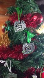 These two angel ornaments are all I have of two of my children. There are no headstones to lay daisies upon, or urns to kiss as I passby each morning. It took me a long time to be able to hang these on our tree. I couldn't bare to do it until last year because even the thought of them made me relive a sadness like I'd never known. But, as each Christmas went by without them here, I felt a calling deep in my heart to have a small way to have them here with us throughout the season. So now they each have an angel that gets hung towards the top of the tree with care. I like to think of them watching over the rest of us from their position of high regard. While something will always be missing without them here on Earth, they are carried year round in the hearts of their parents and in the smiles of their brothers. They are thought of not just at Christmas time, but all of the time. So many what ifs, what could've beens, and unanswered questions. So until I'm able to know all of the answers to my many questions, they will each have an angel on our family tree and live on in a very sacred place I keep them in my heart and will until my days on Earth are through and I get to finally hold them in my loving arms. Here's to all of our angels - both on our trees and in our hearts during this season and all year long.